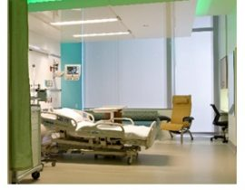 Patient rooms with motorized solar shading from Interior Specialties
