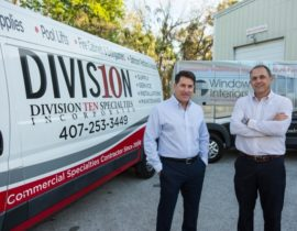 Window Interiors and Division 10 Specialties vans with president and vp